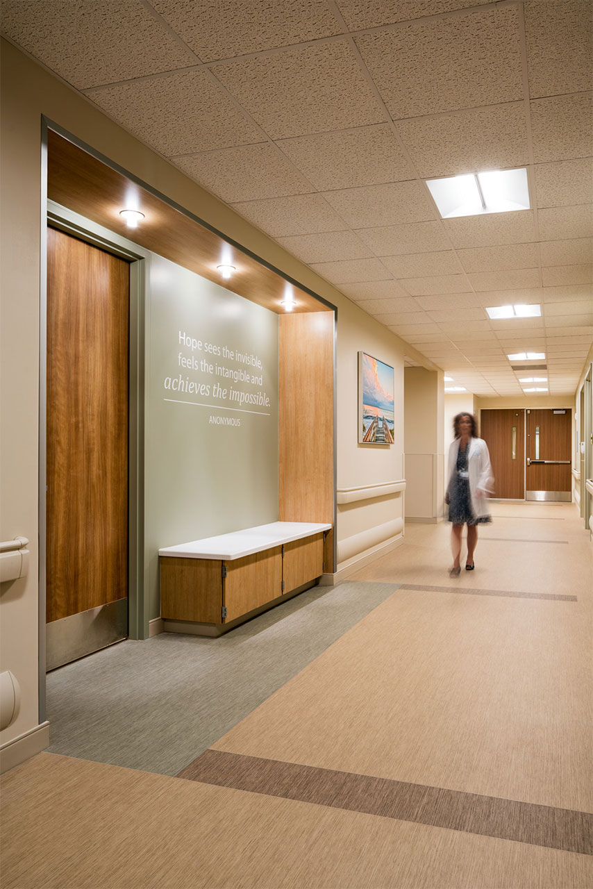 Corridors provide resting niches at regular intervals that serve as destination points during gait training. Inspirational quotes encourage patients to persevere.
